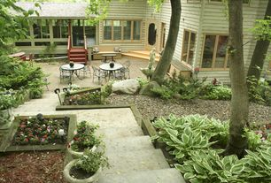 Craftsman Patio with Glass panel door, Pathway, Raised beds, French doors, exterior stone floors