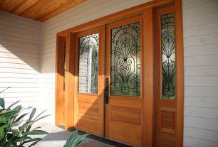 Traditional Front Door with Concrete floors, Box ceiling, Glass panel door