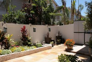 Mediterranean Landscape/Yard with Raised beds, exterior terracotta tile floors, Fence, exterior tile floors