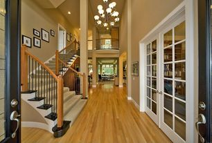 Traditional Staircase with Chandelier, onyx tile floors, French doors