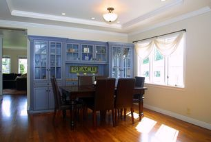 Eclectic Dining Room with flush light, Crown molding, Hardwood floors
