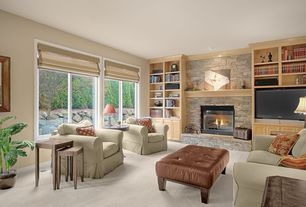 Traditional Living Room with stone fireplace, Carpet, Built-in bookshelf