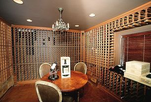 Traditional Wine Cellar with Chandelier, Built-in bookshelf, Hardwood floors