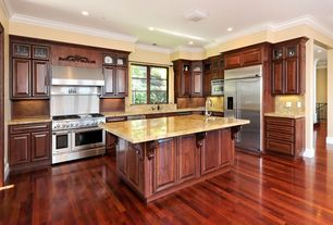 Traditional Kitchen with High ceiling, Laminate floors, Crown molding, L-shaped, Kitchen island, Undermount sink, Glass panel