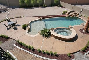 Traditional Swimming Pool with exterior herringbone tile floors, exterior tile floors, Fence, Pool with hot tub