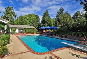Traditional Swimming Pool with Outdoor kitchen, exterior tile floors