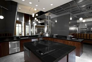 Modern Kitchen with Kitchen island, European Cabinets, L-shaped, Concrete floors, Undermount sink, Pendant light, Soapstone