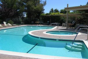Modern Swimming Pool with exterior interlocking pavers, exterior tile floors, Trellis, Fence, Pool with hot tub
