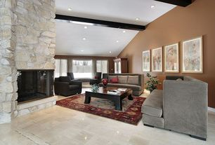 Modern Living Room with Exposed beam, Concrete tile , stone fireplace