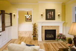 Traditional Living Room with Crown molding, Wall sconce, Hardwood floors, Wainscotting, stone fireplace