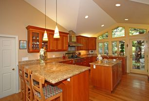 Craftsman Kitchen with French doors, Undermount sink, Kitchen island, Simple granite counters, High ceiling, Simple Granite