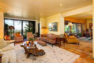 Traditional Living Room with terracotta tile floors, Standard height, sliding glass door, can lights
