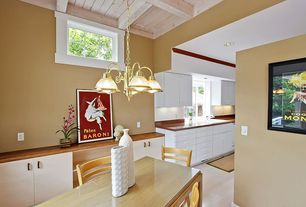 Contemporary Dining Room with Exposed beam, Chandelier, Laminate floors