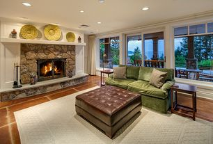 Country Living Room with French doors, terracotta tile floors, Poundex Oversize Brown Faux Leather Ottoman, stone fireplace