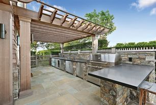 Contemporary Patio with exterior stone floors, Fence, Outdoor kitchen, Gate, Trellis