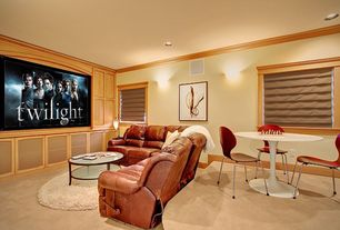 Contemporary Home Theater with Tendy stacking chairs, Roman shades, Carpet, Custom casework, Wall sconce, Tulip dining table