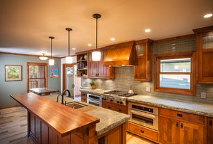 Craftsman Kitchen with Crown molding, European Cabinets, flush light, Ceramic Tile, Custom hood, electric cooktop, Flush