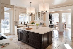 Contemporary Kitchen with Crown molding, Kitchen island, Breakfast bar, French doors, Large Ceramic Tile, Chandelier