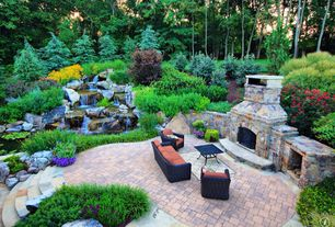Traditional Patio with exterior concrete tile floors, Fountain, outdoor pizza oven, exterior tile floors, Raised beds