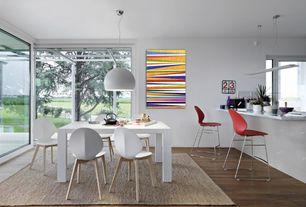 Modern Dining Room with Artemide nur 1 light bowl pendant, Calligaris basil small bar stool, Hardwood floors, Pendant light