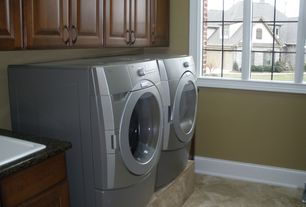Traditional Laundry Room with laundry sink, Standard height, limestone floors, Drop-in sink, Built-in bookshelf