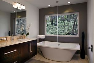 Contemporary Master Bathroom with Freestanding bathtub, specialty door, Freestanding, Undermount sink, quartz tile floors