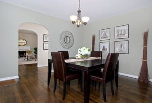 Modern Dining Room with Cement fireplace, Chandelier, Hardwood floors