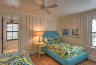 Cottage Guest Bedroom with Standard height, Hardwood floors, Ceiling fan, Crown molding, double-hung window