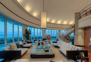 Modern Living Room with Chrome Sapphire Pendant, High ceiling, Pendant light, Balcony, Laminate floors, Raleigh Sofa
