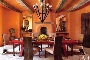 Eclectic Dining Room with Fireplace, Standard height, specialty door, Chandelier, Exposed beam, Cement fireplace
