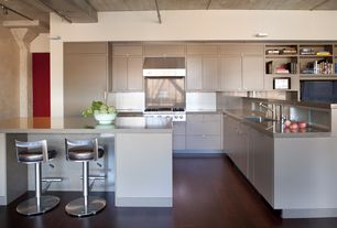 Modern Kitchen with Quartz counters, Exposed pipes, Gas range top, Slab cabinet doors, Kitchen island, Paint 1, Paint 2