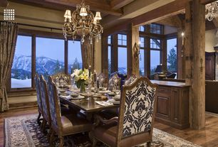 Rustic Dining Room with Hardwood floors, Dreka Mahal Rug, 10' x 14', picture window, Two Colette Side Chairs, Columns, Paint