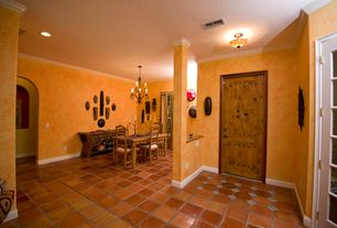 Mediterranean Entryway with Crown molding, terracotta tile floors, A&B Home Group, Inc X5 Candelabra, flush light
