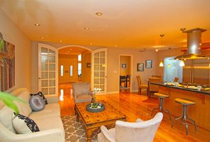Traditional Living Room with Built-in bookshelf, Pendant light, French doors, Hardwood floors