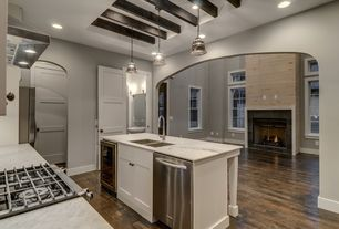 Traditional Kitchen with U-shaped, dishwasher, Pendant light, Wall Hood, Exposed beam, Wine refrigerator, can lights, Flush