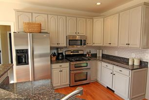 Traditional Kitchen with Inset cabinets, Undermount sink, Hardwood floors, Standard height, built-in microwave, Raised panel