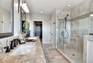 Traditional Master Bathroom with Undermount sink, Stone Tile, Complex granite counters, Handheld showerhead, specialty door