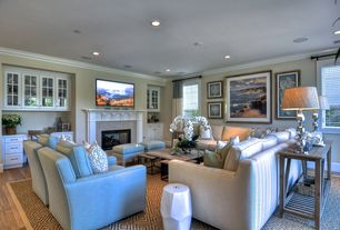 Traditional Living Room with Hardwood floors, Prairie mission sofa table., stone fireplace, Crown molding, Built-in bookshelf