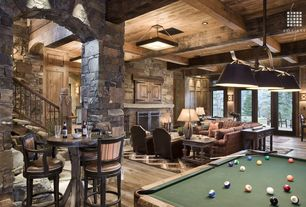 Country Game Room with Pendant light, Columns, Hardwood floors, Exposed beam, High ceiling