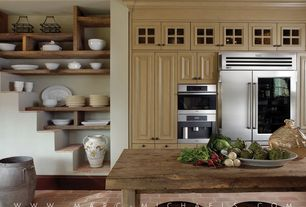 Country Kitchen with Glass panel, Wood counters, Breakfast bar, Raised panel, One-wall, Kitchen island, limestone tile floors