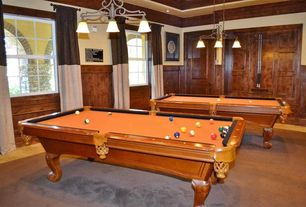 Craftsman Game Room with Area rug, Pool table, Color blocked curtains, Wainscotting, Pendant light, travertine tile floors
