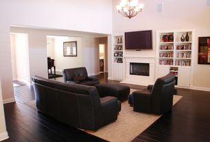 Modern Living Room with Built-in bookshelf, Columns, Chandelier, Bamboo floors, High ceiling
