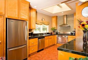 Kitchen with U-shaped, Skylight, Flat panel cabinets, Penny Tile, Soapstone counters