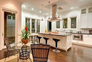 Modern Kitchen with Crown molding, Breakfast nook, Breakfast bar, Undermount sink, Kitchen island, Glass panel, French doors