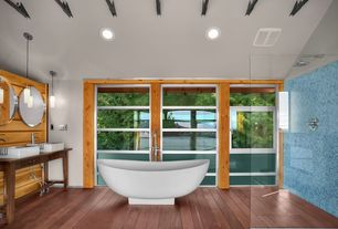 Contemporary Master Bathroom with Pedestal sink, frameless showerdoor, Hardwood floors, Wood counters, Exposed beam