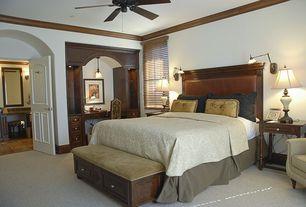 Craftsman Guest Bedroom with Wall sconce, Crown molding, Pendant light, Art desk, Ceiling fan, Carpet