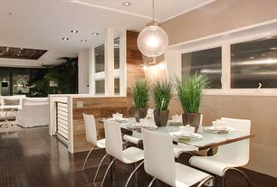 Contemporary Dining Room with Standard height, Hardwood floors, specialty window, can lights, Pendant light