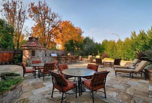 Eclectic Patio with Outdoor kitchen, Fence, exterior tile floors