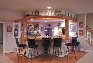 Eclectic Bar with Hardwood floors, Built-in bookshelf, High ceiling, Pendant light, can lights