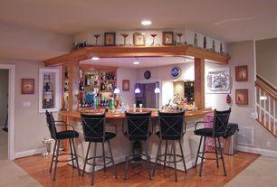 Eclectic Bar with High ceiling, Built-in bookshelf, Pendant light, Hardwood floors